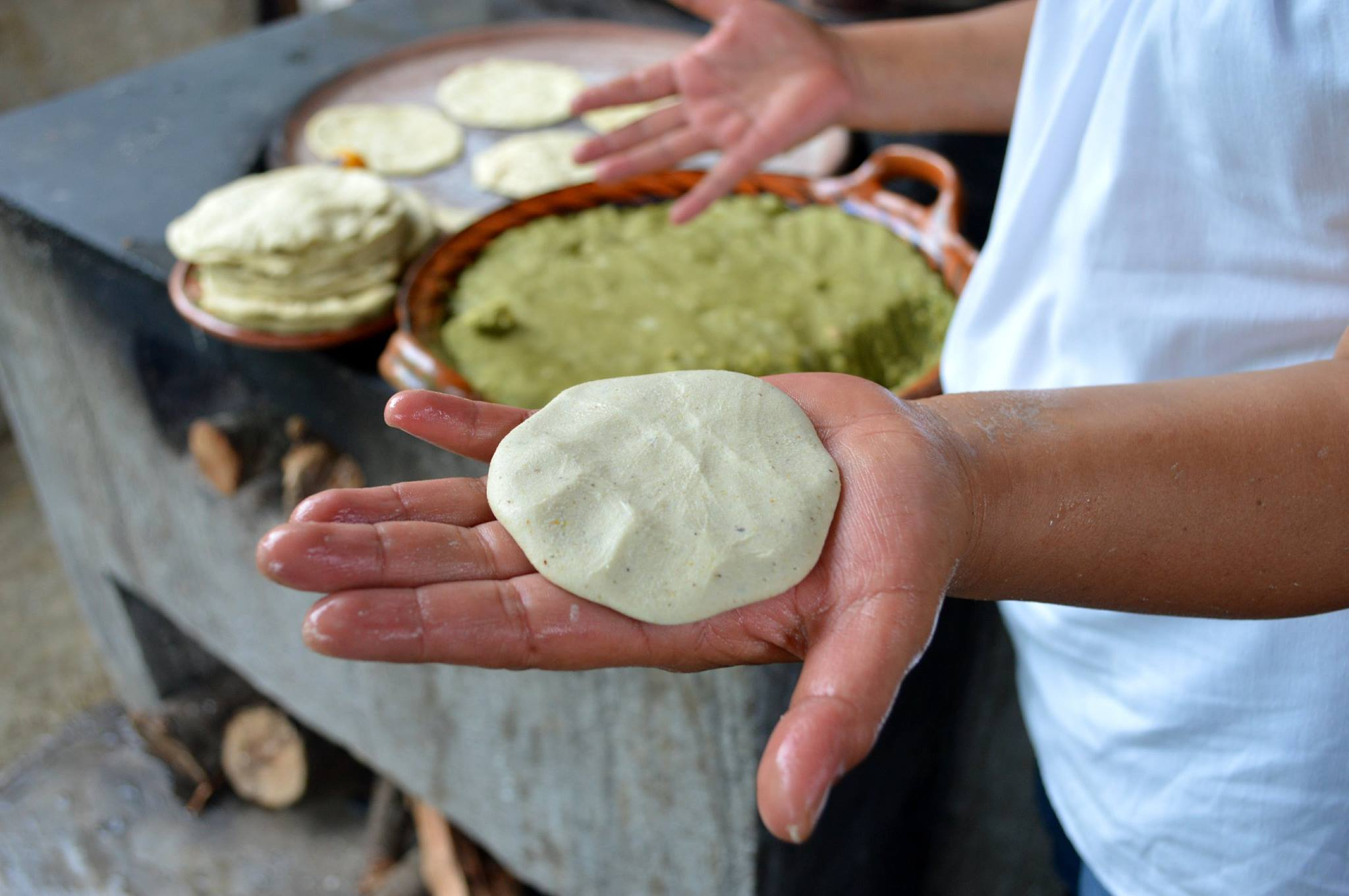 """Despite the cruelty of the Spanish Empire, the ancient cultures have survived"" says Paco, ""and deep in the mountains, they are still so vibrant."" Here, a traditional cook in the hills of Puebla teaches Paco's guests to prepare homemade  tlayoyos  with  alberjón  (a type of fava)."