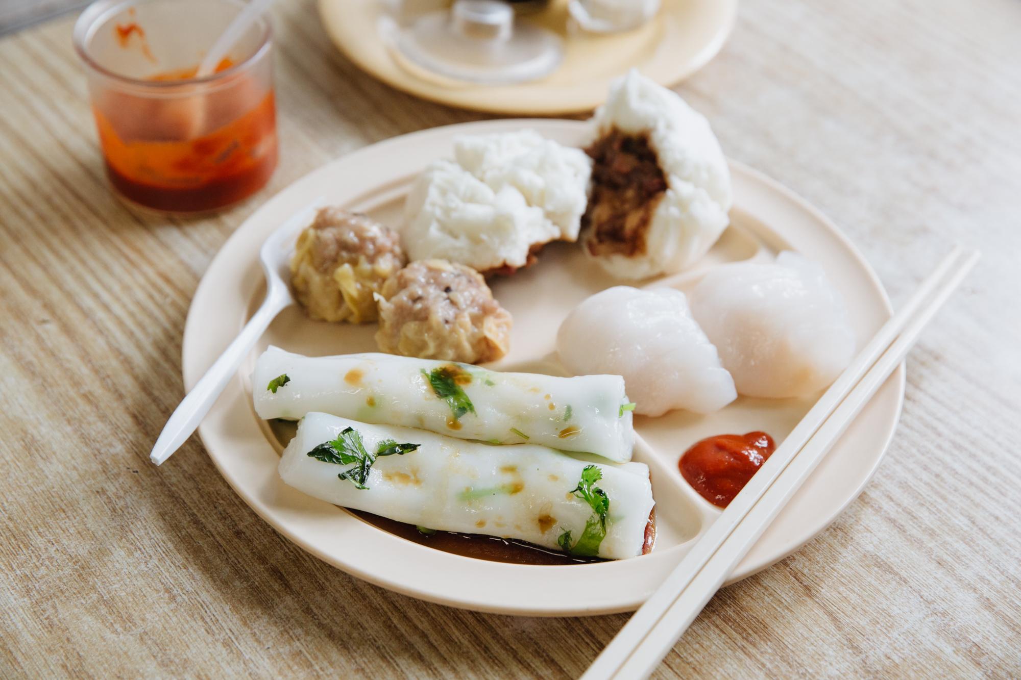 Rice rolls, char siu bao (steamed pork bun), har gow (shrimp dumpings) and siu mai (pork and shrimp dumplings).