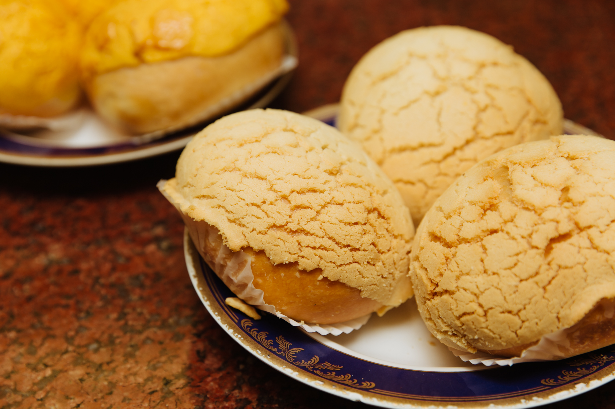 Pineapple buns got their name because the sweet crackled top resembles a pineapple exterior.