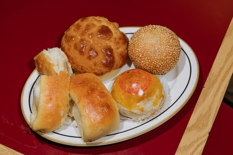 An assortment: pineapple bun, coconut bun (aka cocktail bun), red bean pastry and sesame ball