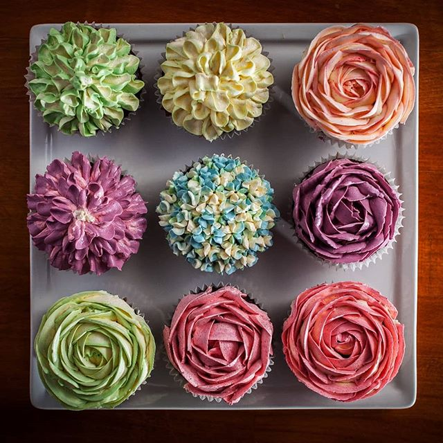 Vegan flower cupcakes. Vegan-friendly chocolate cupcakes with not-buttercream rosettas on top. Available all stores. Contains Gluten. Does not contain nuts, but may contain traces of nuts.