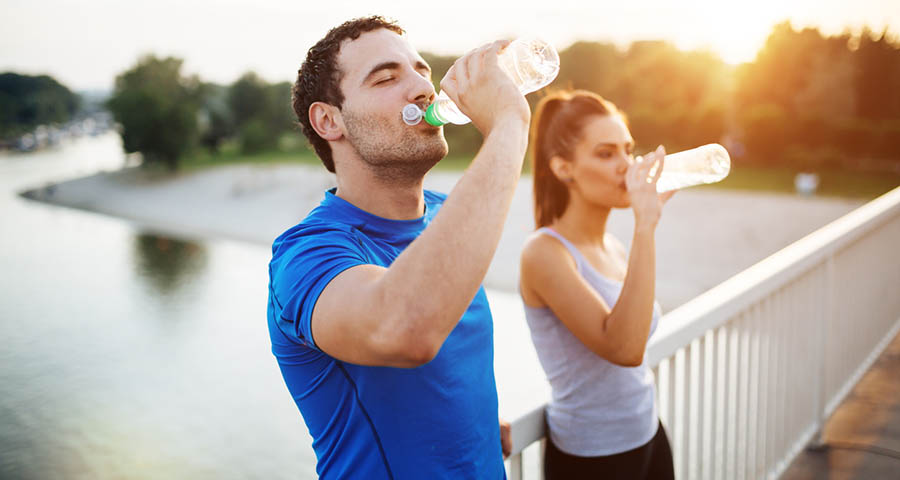 man and woman drinking water copy.jpg
