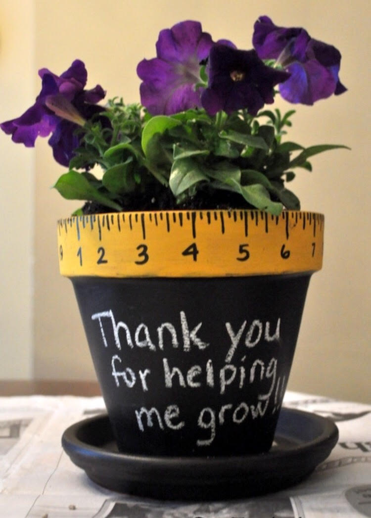 Potteplante med teksten: Thank you for making us grow.