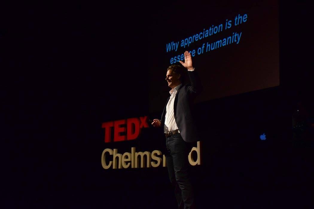 Caspar on TED Stage.jpg