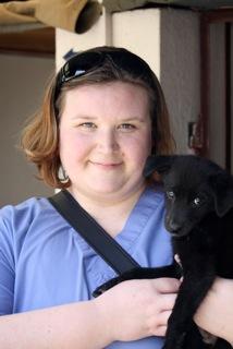 Volunteers love puppies love volunteers.