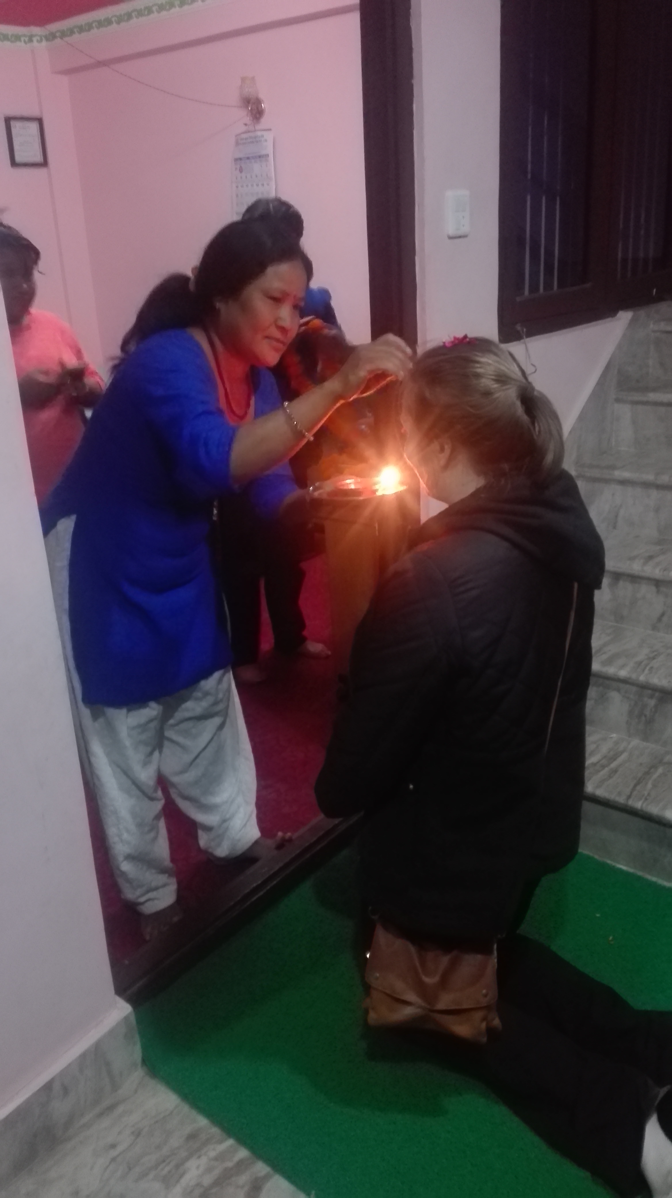 Volunteers recieve a blessing at arrival.