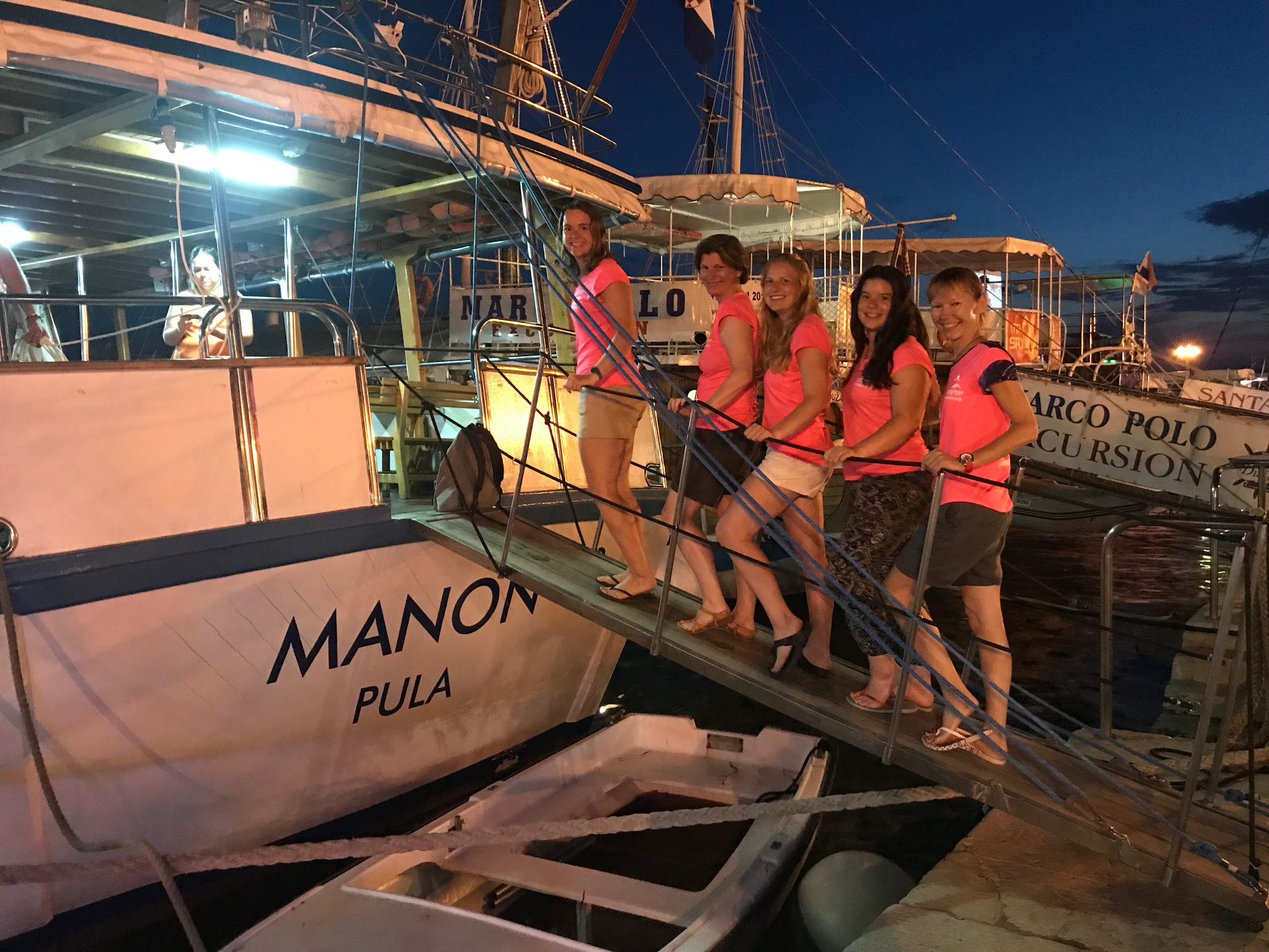 volunteer team on a boat