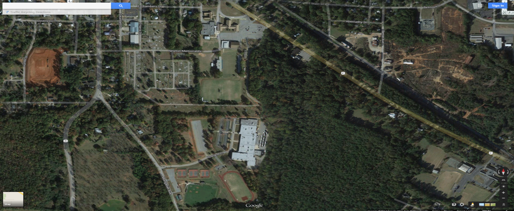 Aerial View of Main Campus – has 28 acres, divided by the cemetery into North and South campus. North campus has middle school classrooms, gym, BOE Adm building, some parking, football stadium, and practice fields. South Campus has High School building, student & faculty parking, track, baseball, 6 tennis courts and entrance. Notice Montpelier Road can be widened to three lanes for traffic since it is a county road.