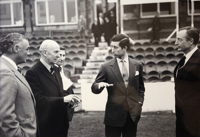 GRE explains back spin to HRH Prince Charles at the Oval cricket ground.
