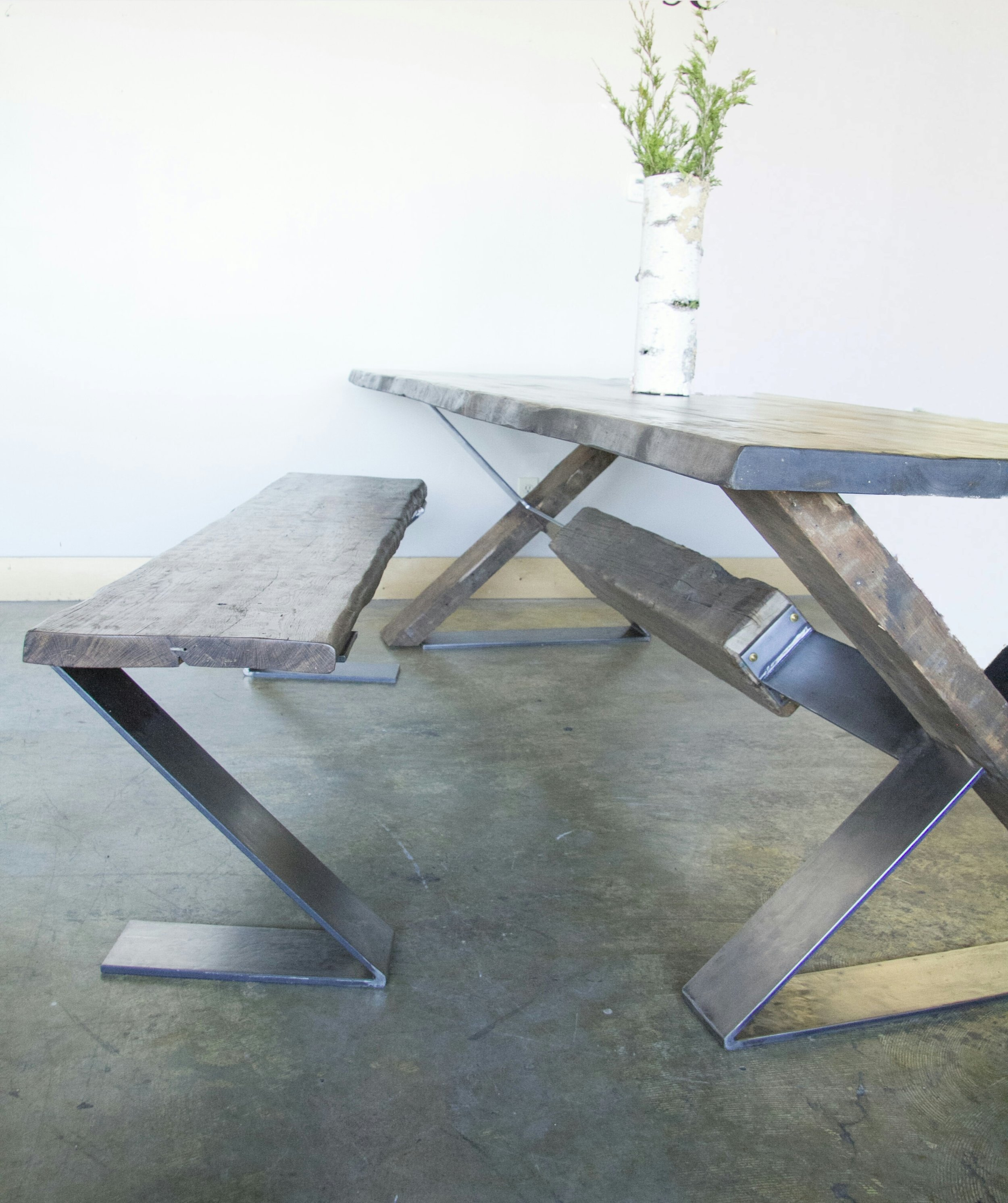 - The design for this table is centered around the a beam of wood reclaimed from a theater in St. Louis city. It was commissioned by a couple from St. Louis after seeing a picture of the beam on our Instagram page.