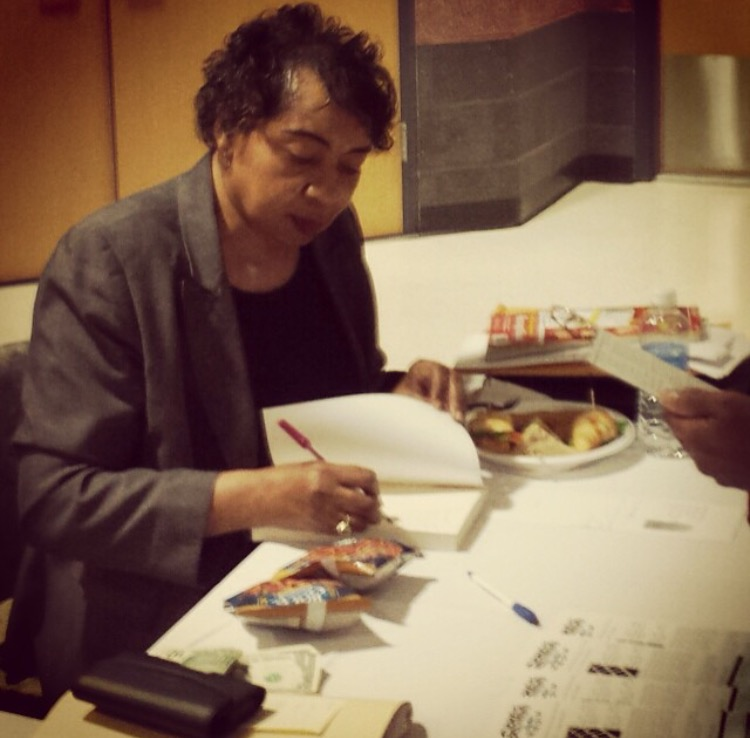 Clara Small signs copies of  Compass Points  after a lecture at Wor-Wic Community College.