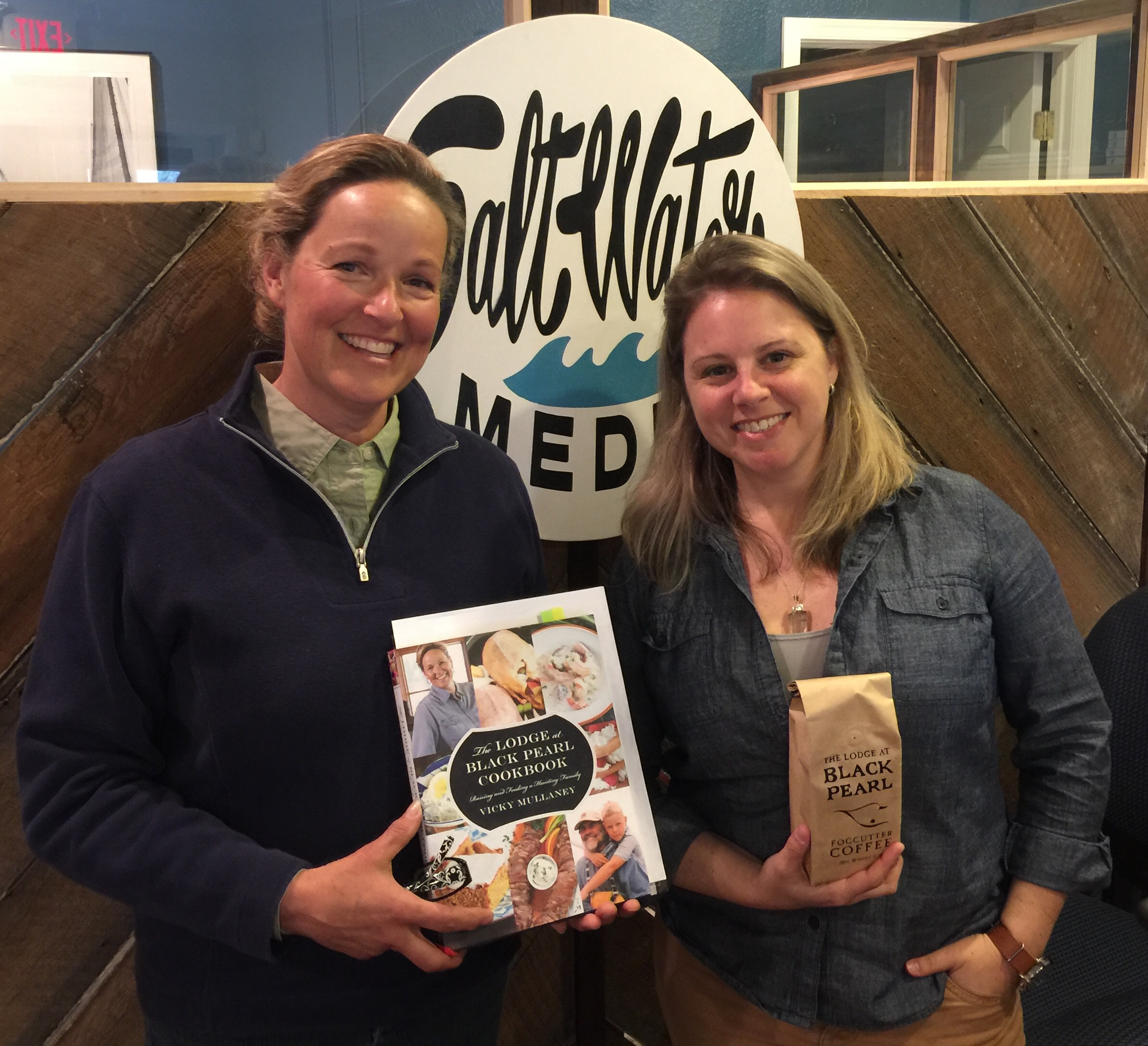 Vicky Mullaney shows off her newest creation, The Lodge at Black Pearl Cookbook, and her coffee blend, which she gave to Stephanie.