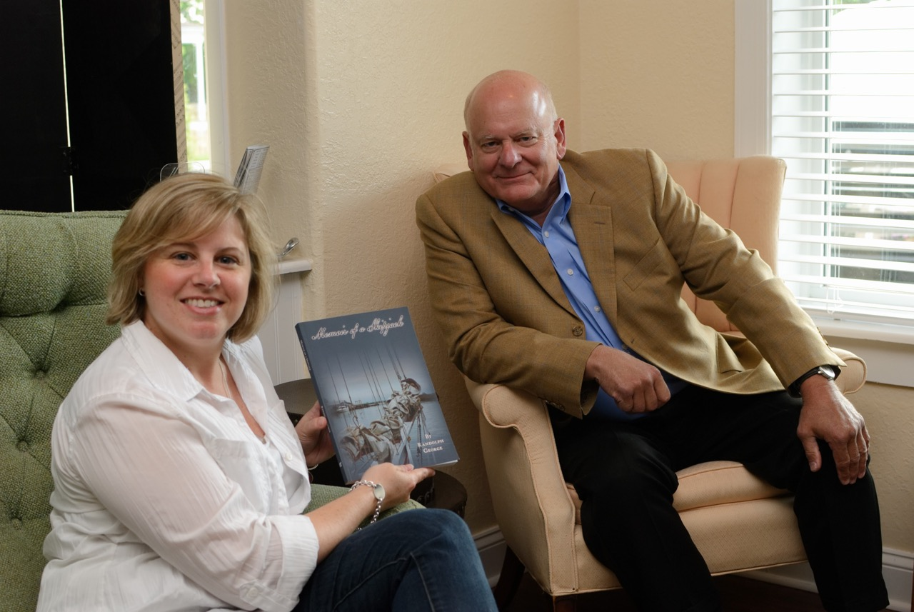 "Stephanie holding ""Memoir of a Skipjack"" with its author, Randolph George"