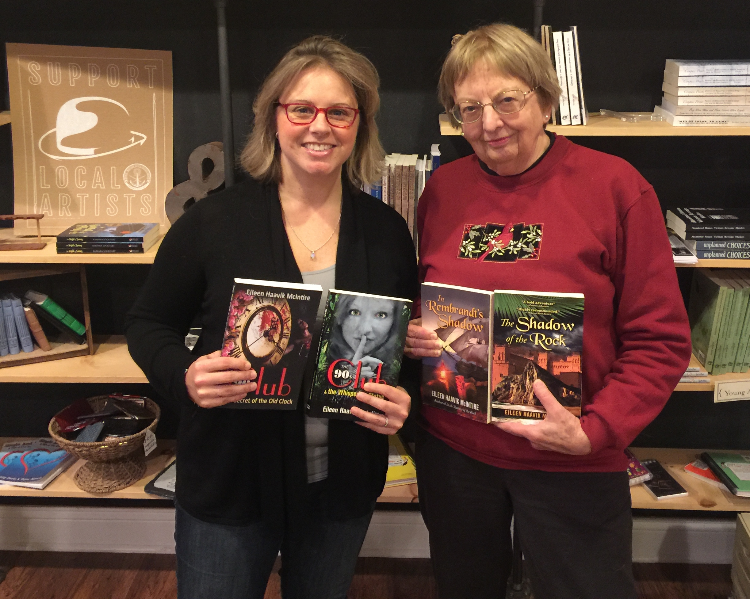 Eileen Haavik McIntire (right) shows off her books with Stephanie (left) after the podcast.