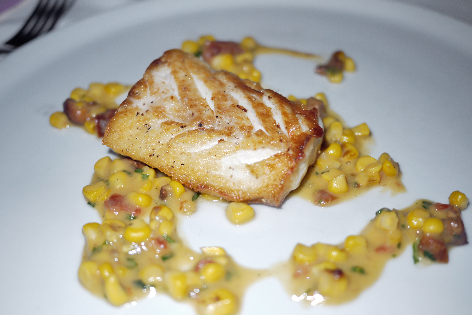 Wild Striped Bass with sweet corn and tomatoes