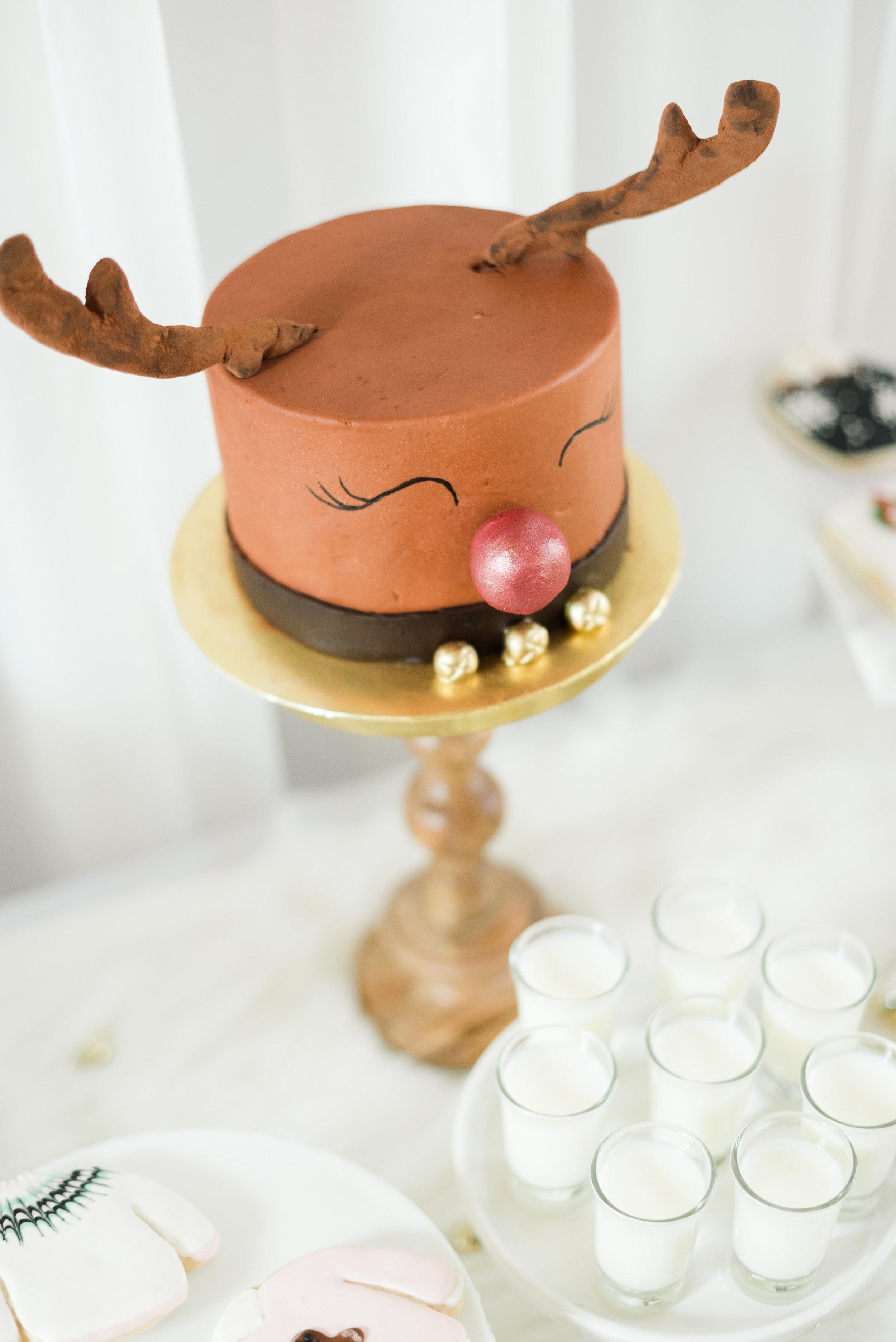 Rudolph-Themed-Cake-and-Christmas-Dessert-Display