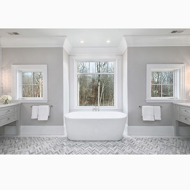 Rise and shine! Loving this @fletchercustomhomes master bathroom with awesome herringbone floor tile by @dndhomesllc . . . . . . #fletchercustomhomes #fletcherdevelopmentllc #modern #development #construction #interiordesign #views #architecture #bath #developer #builder #luxury #luxuryhome #architect #luxuryhouse #luxurylife #luxurylifestyle #homestyle #lights #homestyling #design #homestyle #architectsofinsta #luxuryhomes #homeoftheday #fletcher #summer #tub #relax #bubbles #summernights @builders.of.insta @benjaminmoore @buildertrend @luxury_homes