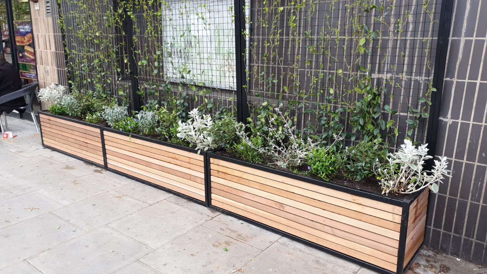 close view of archway underground station planters