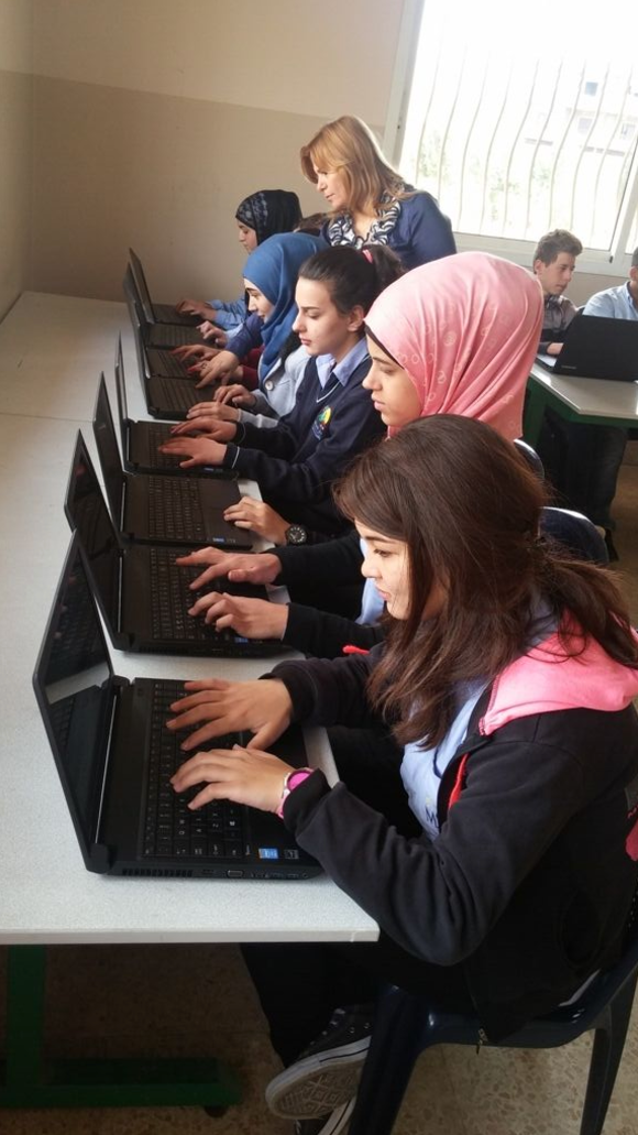 students at computers from another comScore donation