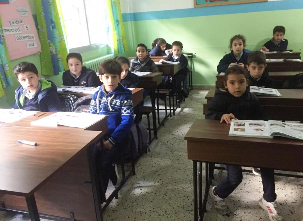 The students of Our Lady of Assumption School in their new desks