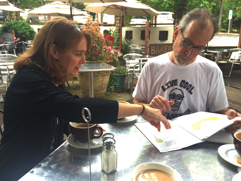 Ginger and Daniel review an early proof of the book.