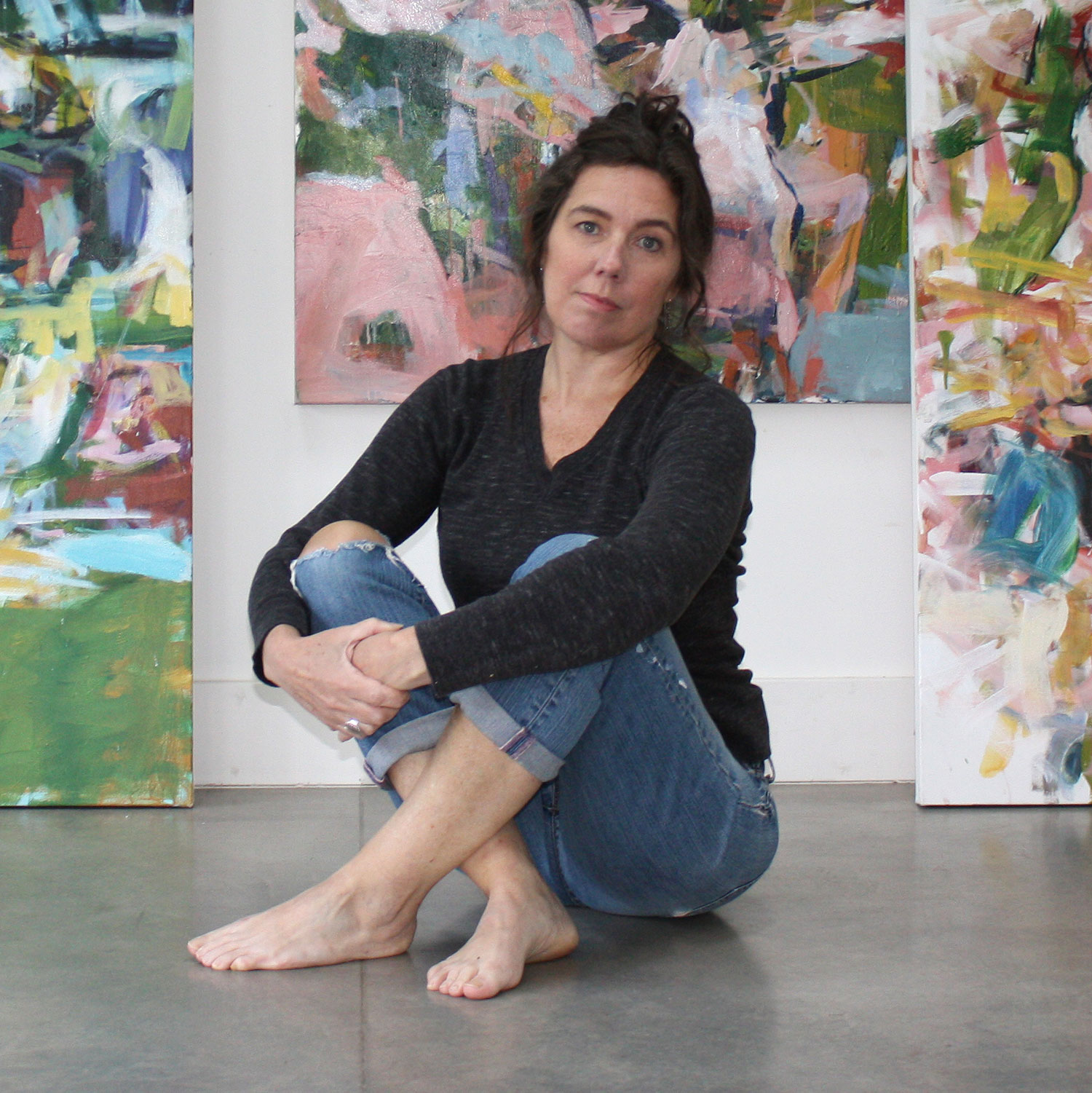 karen-silve-sitting-with-paintings.jpg
