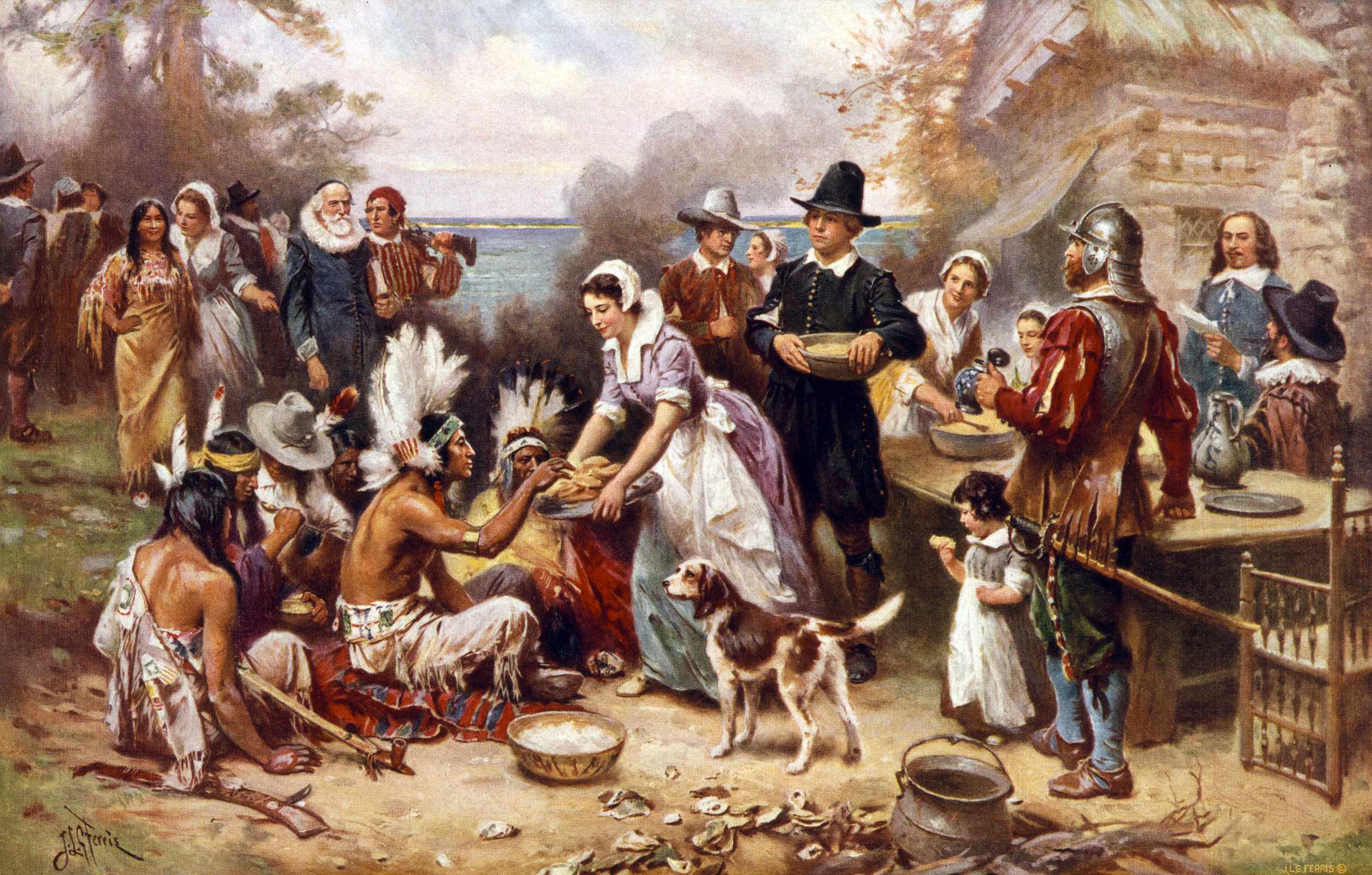 This 1932 painting shows a version of the first Thanksgiving. The Wampanoag would not have had feather headdresses.