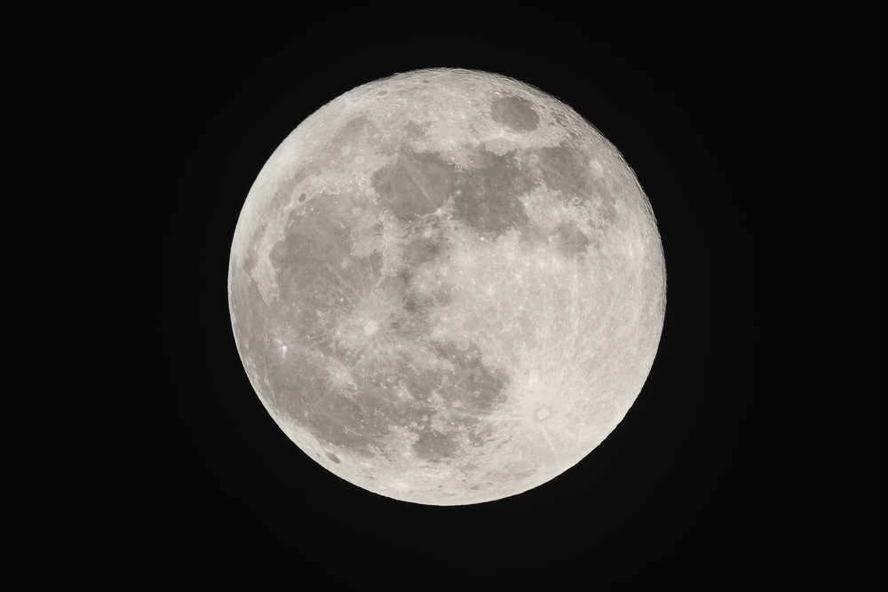 The Moon is 384,400 km away from the Earth.