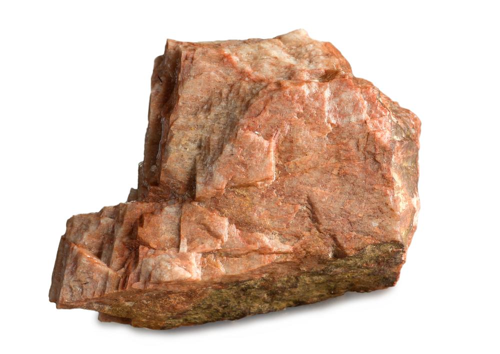 Feldspar is transformed into clay and silt by hydrolysis.