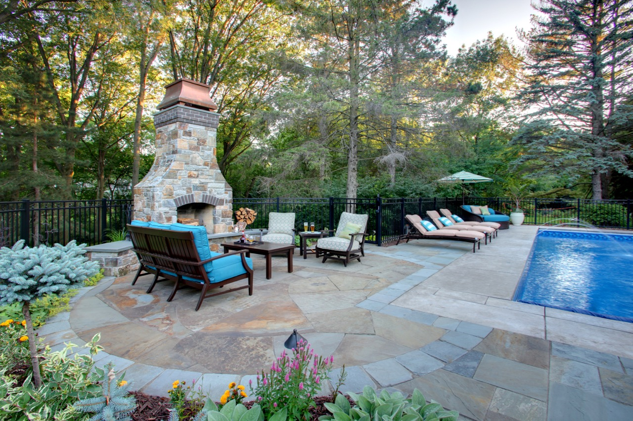 Mom's Design Build - Natural Stone Poolside Fireplace