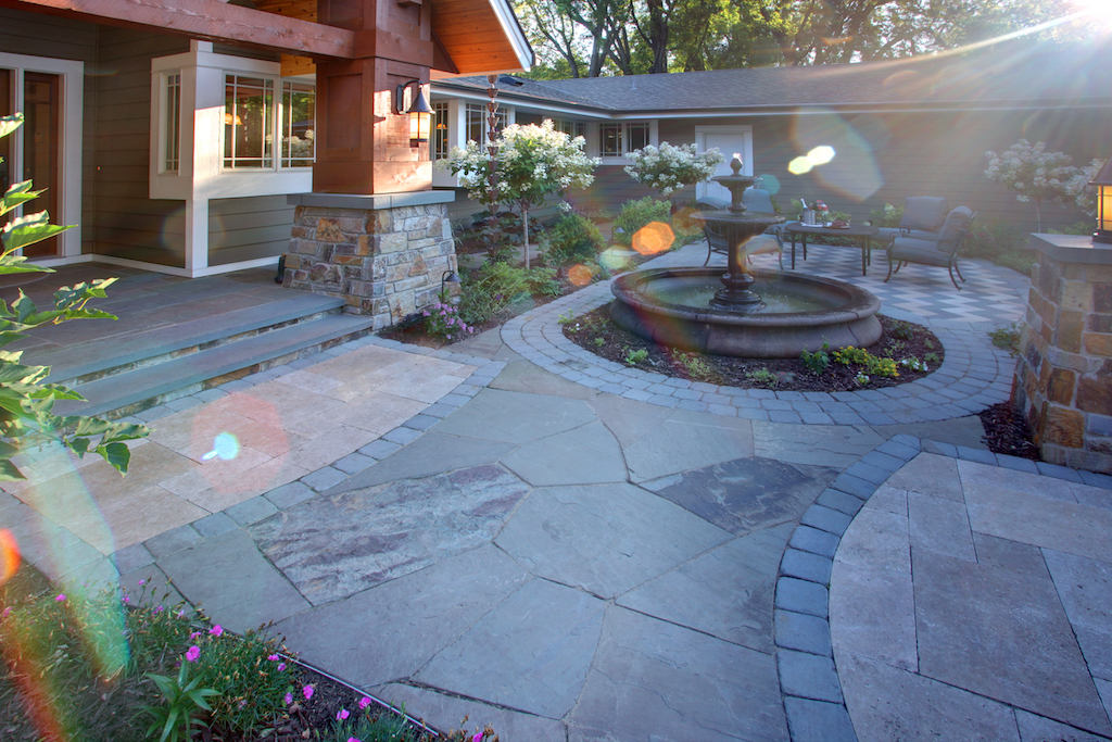Mom's Design Build - Natural stone patio with elegant water feature