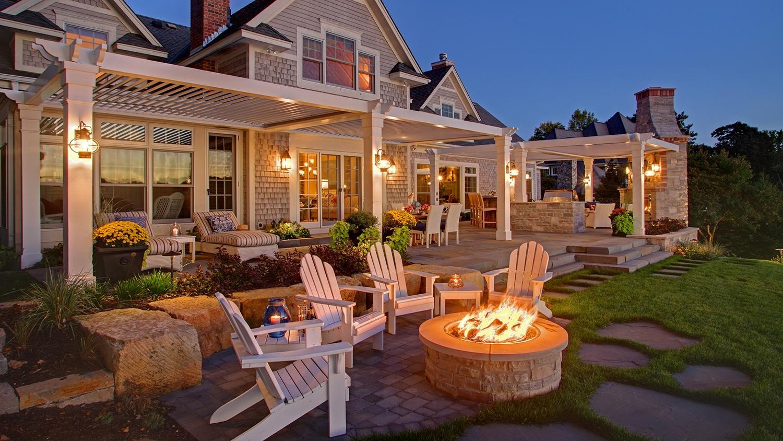 Mom's Design Build - Lake Minnetonka backyard fireplace natural stone patio
