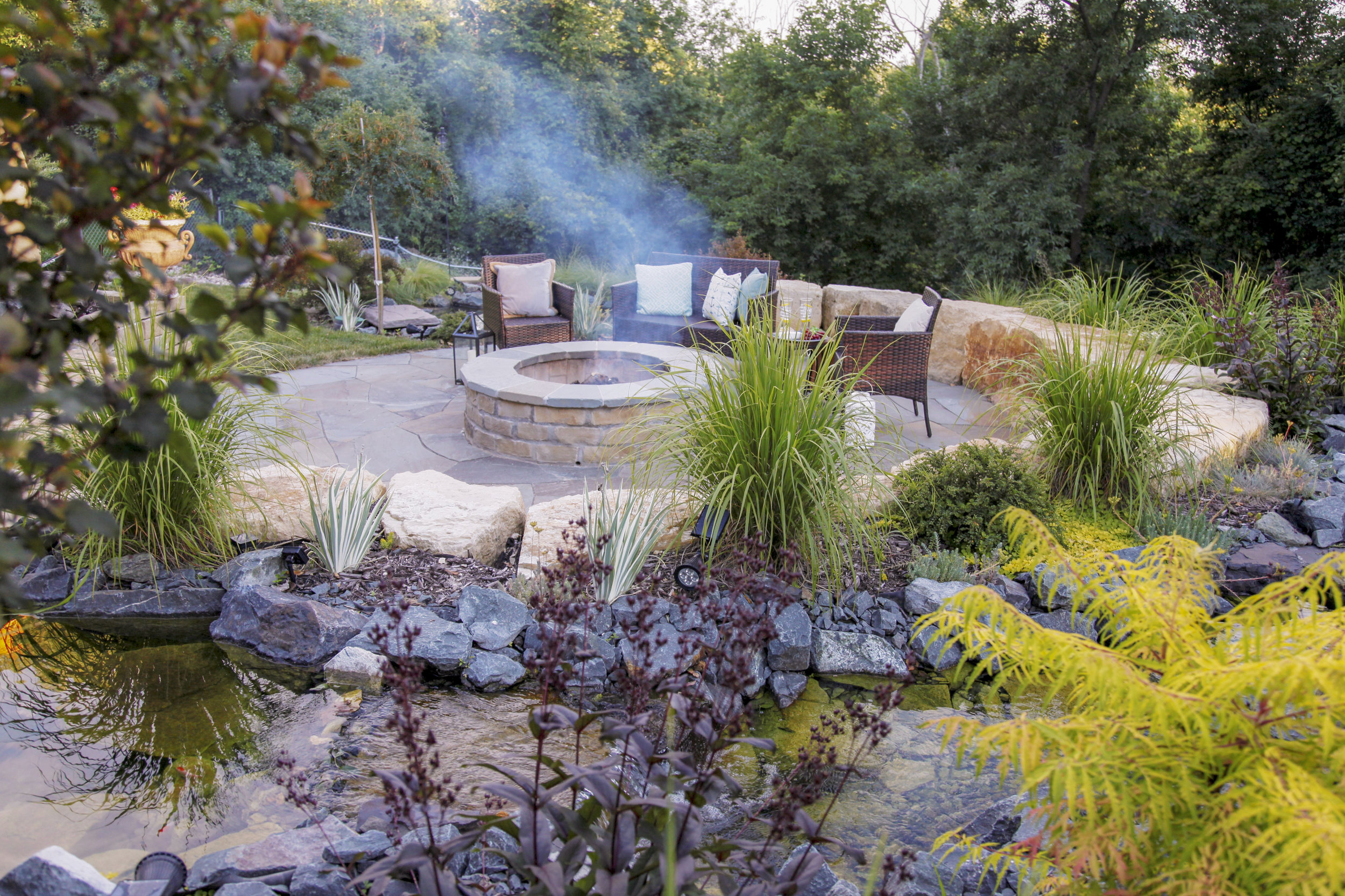 Moms Design Build - Water Feature Water Plants Fire Pit.jpg
