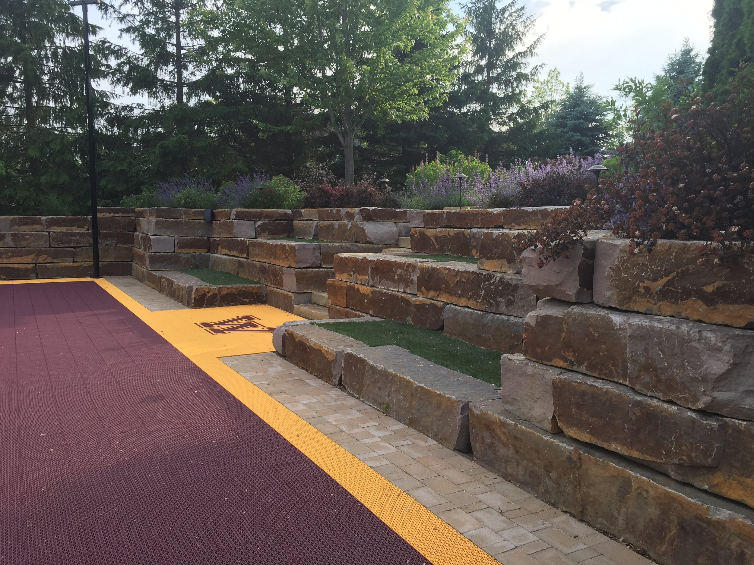 A maroon and gold court paired with the Gopher's logo supports the home-town team.