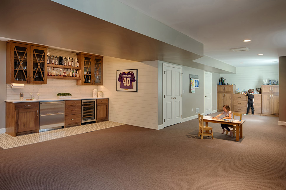 This basement maximizes space for multipurpose functionality.