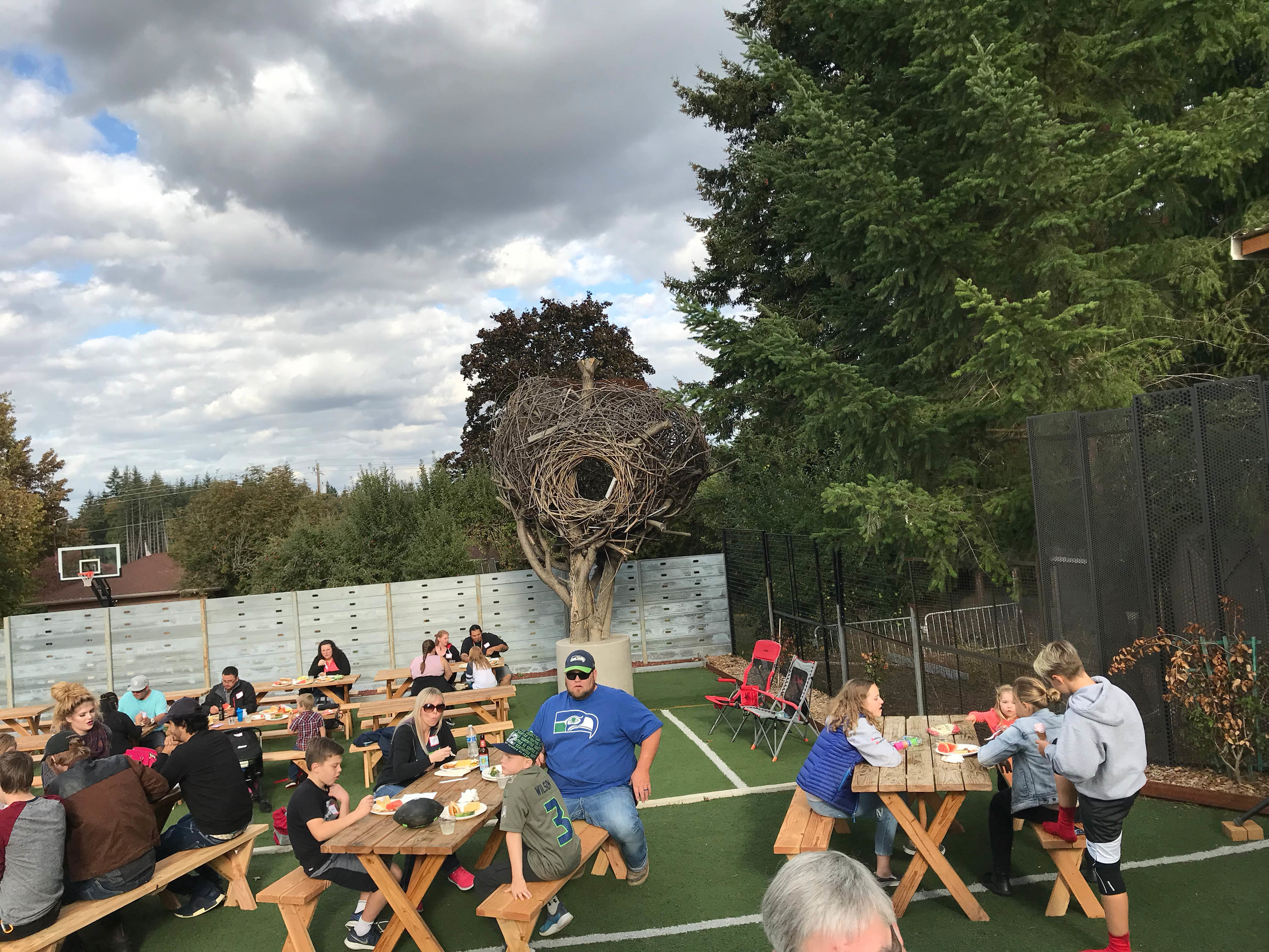 Company picnic w/ the nest in the background