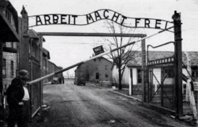 """Arbeit macht frei"" (work sets you free) sign at the Auschwitz Nazi death camp in Poland"