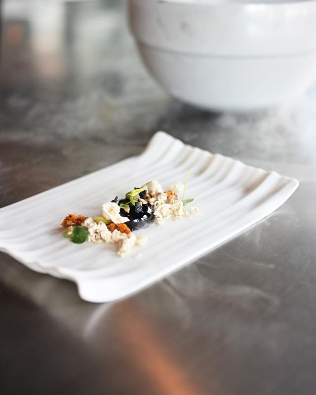 """#Throwback to """"Sunflower,"""" created with Burnt Honey, Black Cocoa & Celery. Book your dining experience—now offering a 7 course tasting for $75, 10 for $95 & 15 for $150—at squarerootnola.com/tickets/. Link in Bio. #NOLAeats"""