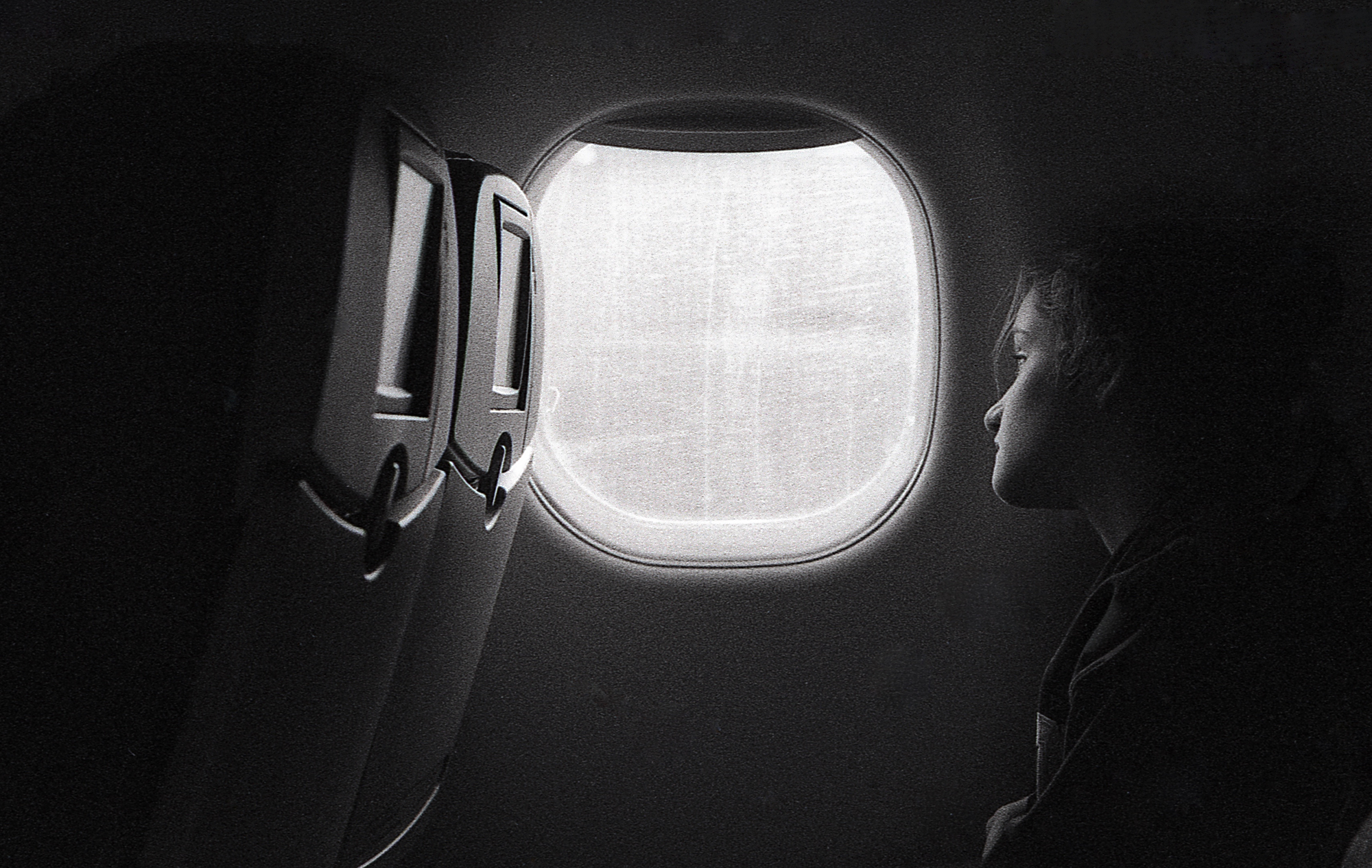 Madi Kneipp, 14, peers out the window on her flight from Raleigh, NC to Fort Lauderdale, FL on November 23, 2016. (Delta 400 pushed to 1600)