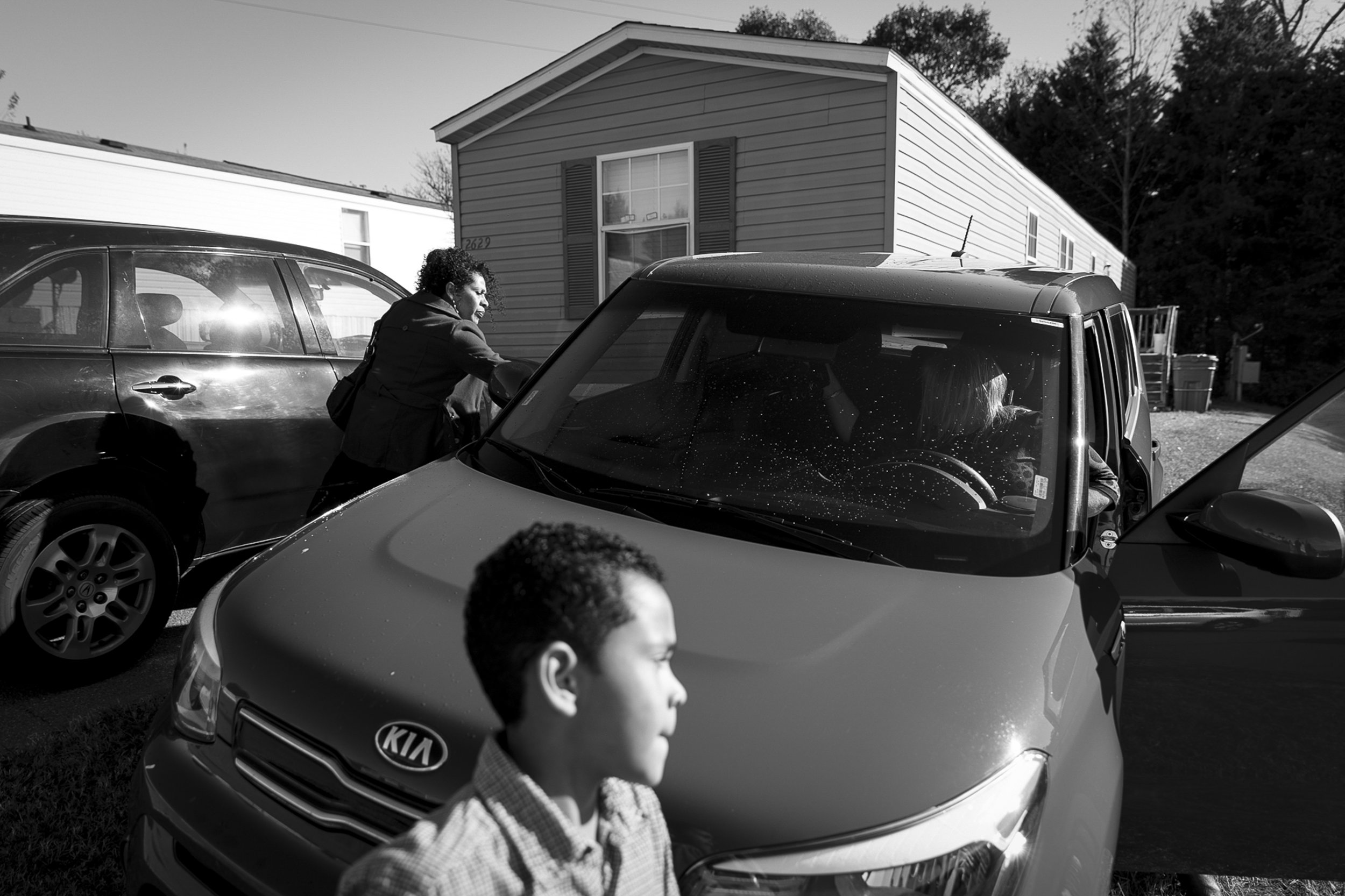 Minerva (left) and Antonio (center) get a ride to her meeting with ICE in Charlotte, NC on Nov. 16, 2017 from Kim Porter (right), a social activist who has been working with Minerva since the beginning of her case. Minerva cannot legally drive, so she relies on friends and family to get her around. Minerva is currently working on getting her driver's license.