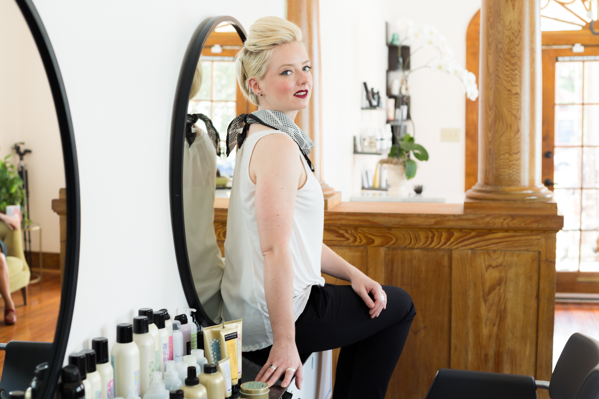 """Jo Morris - Stylist   Colorist  Jo has always loved cutting and styling hair, particularly the vintage looks. As a graduate of John Jay Beauty College, she started her career at Sweet Olive from our beginning in 2017 as an assistant to Andrea. She has rapidly grown her clientele by always listening to the individual needs fo her clients. Jo's great hair cutting styles have expanded over the years to include creative color clients as well. Consult with Jo today!  Fun Facts: Jo's skills are not at all limited to cosmetology, she is also a talented singer & musician.  Pets: Jo LOVES Cats.  Review:  """"I went in to Sweet Olive a couple of days ago for a haircut with Jo. I'd been to the salon before and have always gotten great cuts, but the other day was really exceptional.   In the last 6 months, I've lost about half the volume of my hair due to a recent change in medication. The meds are necessary, and the hair loss has been devastating. It feels vain to say, but the thinning made me so self-conscious that it was starting to significantly impact my quality of life. I booked a last minute appointment that morning in a desperate attempt to do SOMETHING that would make me feel better.   During my appointment, Jo listened to my concerns and the struggles I've been having with my hair. She came up with several ideas about how to hide the thin parts and work with my features to create a cut that would feel more comfortable. She was responsive to all of my questions and for the first time in a long time, I felt like it was possible to be happy about the way my hair looked.   Throughout the entire cut Jo kept me informed about what she was doing and why, and listened to my feedback. She gave me an absolutely gorgeous cut that far exceeded my expectations. I came in feeling so low about how I looked and when she was finished not only did I feel like myself again, I felt beautiful.   Thanks Sweet Olive for the much needed boost and Jo, you are the best!"""" -   Alissa Luis"""