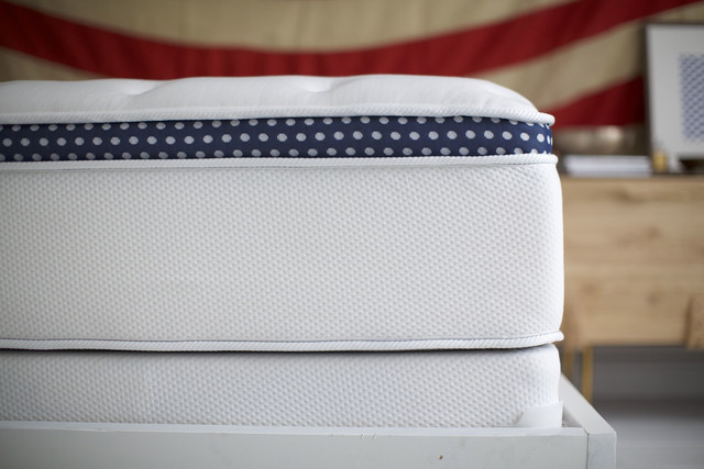 Has a 15 inch high  profile.  Winkbeds  is similar in feel to a luxury hotel mattress.