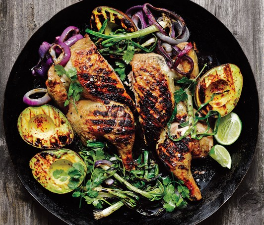 CHICKEN UNDER A BRICK  WITH GRILLED AVOCADO, SCALLION, AND RED ONION FROM BON APPETIT