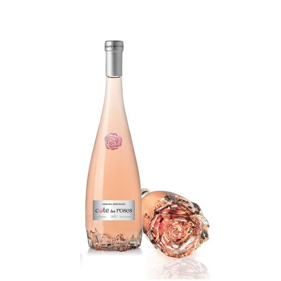 THE COTE DES ROSES ARRIVES IN A BEAUTIFUL ROSE SHAPED BOTTLE WITH GLASS STOPPER. WE FOUND IT AT COSTCO - WHERE THEY HAVE A GREAT SELECTION OF WELL PRICED WINES