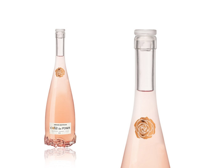 THE BOTTLE BOTTOM IS  SHAPED LIKE A ROSE  TO MAKE A BEAUTIFUL SILHOUETTE.