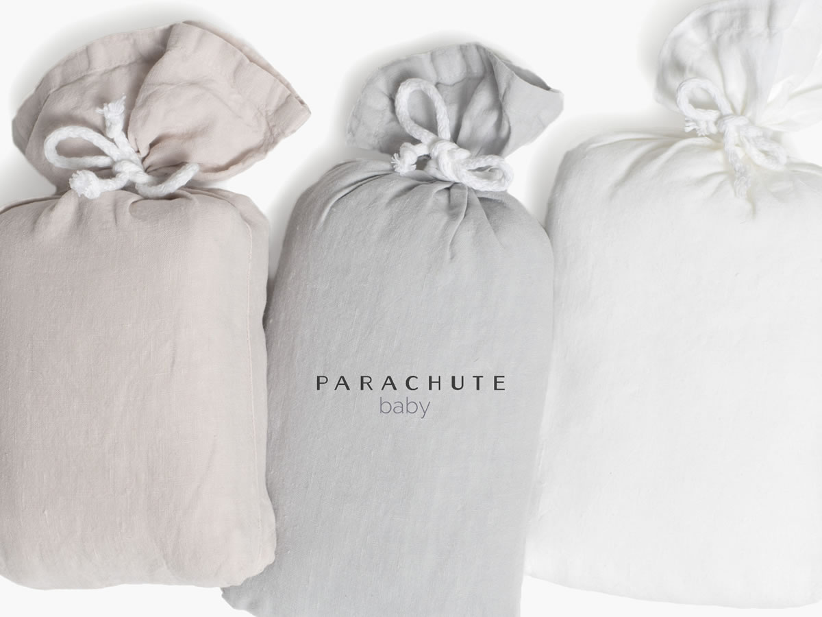PARACHUTE BABY  LINEN CRIB SHEET  PACKAGED IN CUTE LITTLE SACKS MADE FROM THE SAME MATERIAL SO YOU DDON'T HAVE TO GIFT WRAP IT