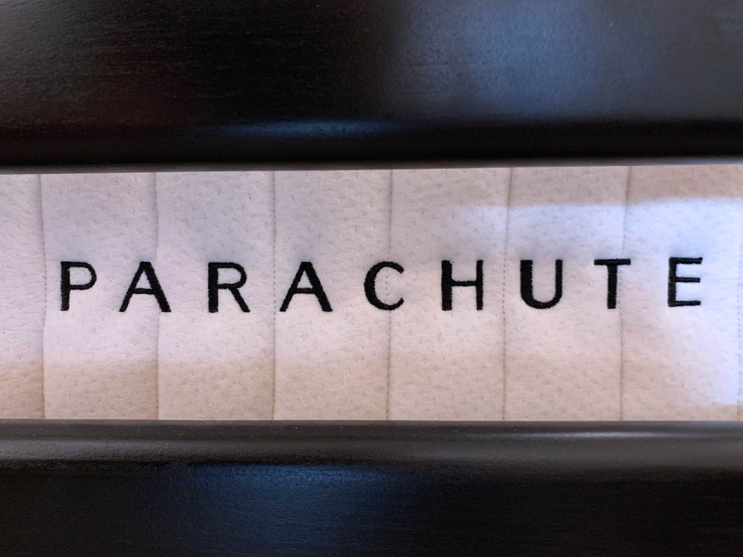 The Mattress by Parachute on a walnut wood frame by Chris Earl