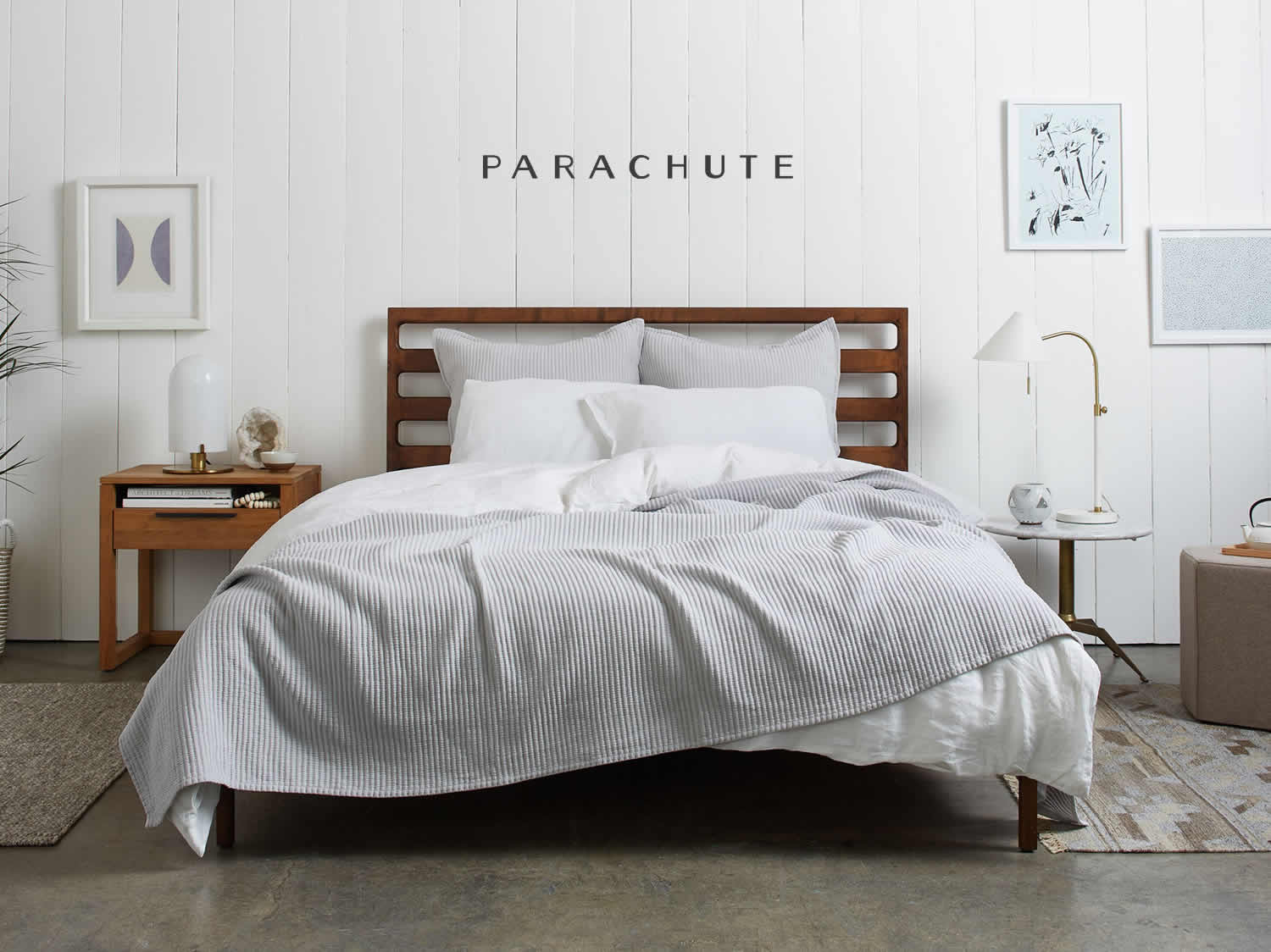 This coverlet by Parachute home  is light-weight blanket that can be tucked-in or left to naturally drape on-top