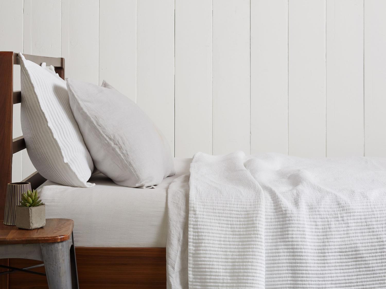 White  matelassé coverlets  and white sham