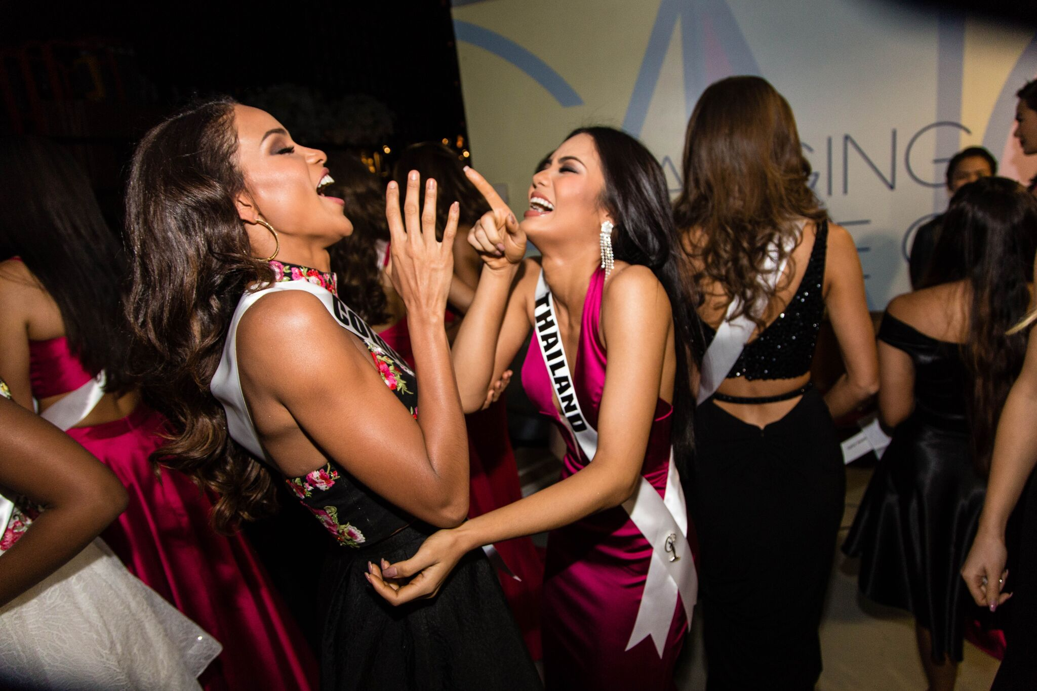 BFF Goals! Miss Colombia, Andrea Tovar and Miss Thailand, Chalita Suansane share a laugh backstage.